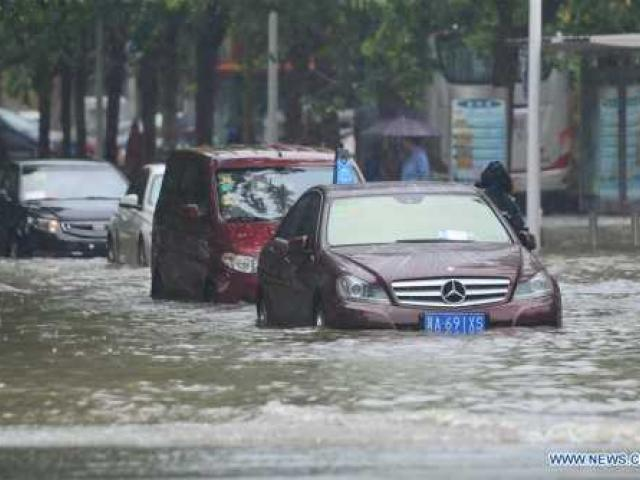 At least 105 killed, 104 missing in China storms