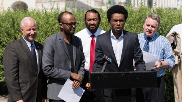 Feyisa Lilesa speaking at press conference in Washington DC about oppression in Ethiopia.