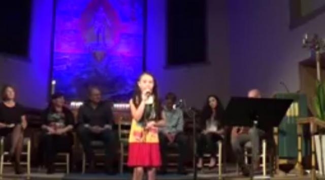 "Dina Matheussen performing Bob Marley's ""Three Little Birds"" on stage"