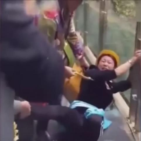 People are terrified to cross glass bridge in China