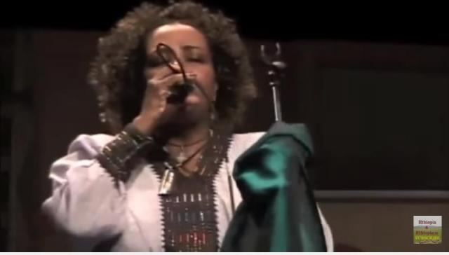 Ethiopian singer Martha Ashagari performing on stage- Astaweskegn