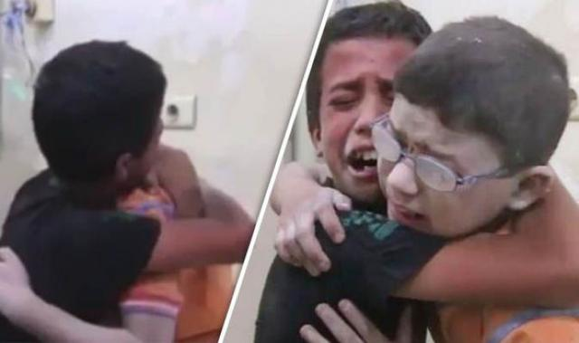 Two Syrian Brothers crying their eyes out after losing their sibling