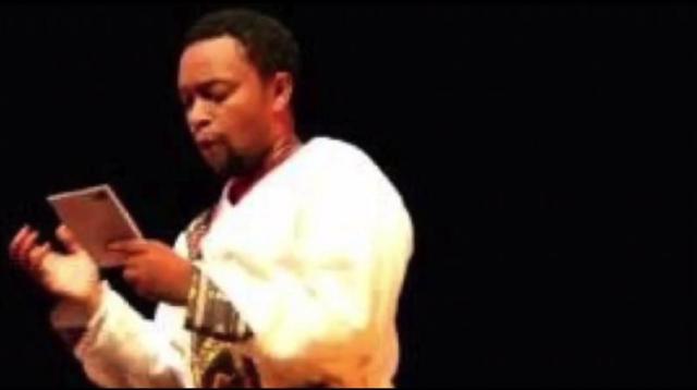 "Beweketu Seyoum reading from his new book ""Ke Amen Basahger"" ከአሜን ባሻገር"