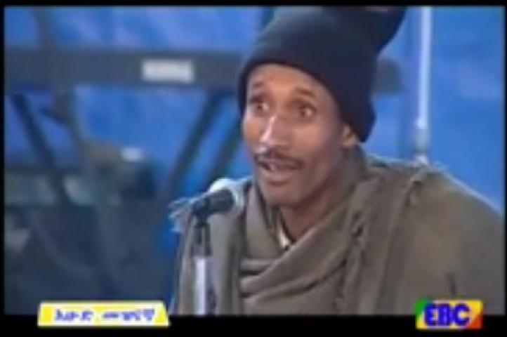 Ethiopian Comedy - Comedian Kibebew Geda on stage