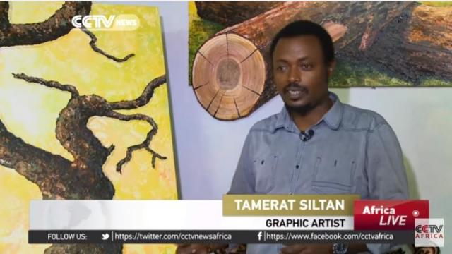 Ethiopian graphic artist paints trees to express views on social issues