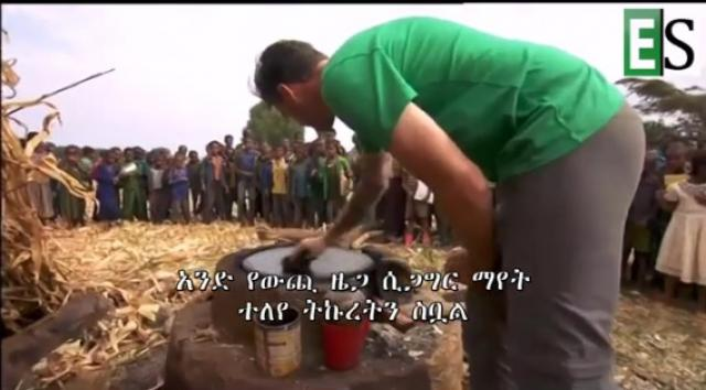 White man making Injera in Ethiopia