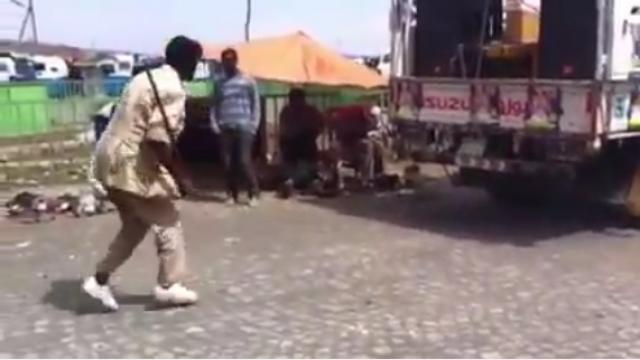 Funny Video - This man cannot do Eskista, but can move his legs for Amharic music