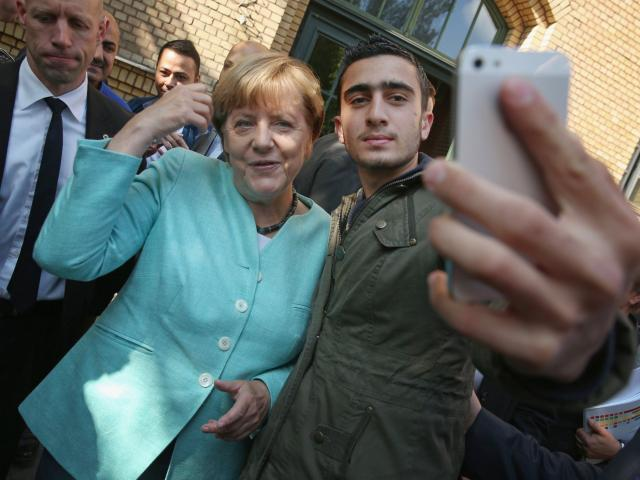 Refugee who took a selfie with Angela Merkel is suin...