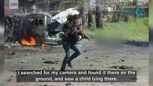 SYRIA Photographer takes action instead of pictures