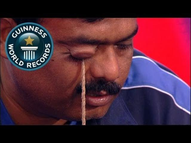 Heaviest weight lifted with the eyelid - Guinness World Records Classics