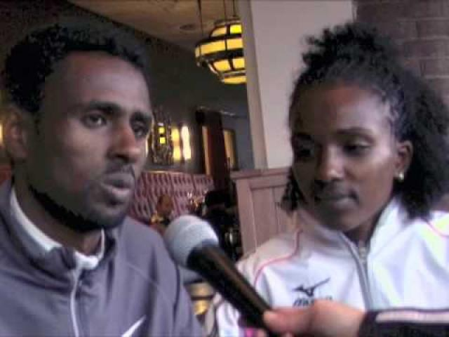 Race footage and interview withTirunesh Diabab. Her husband Sileshi Shihine translates for Tirunesh