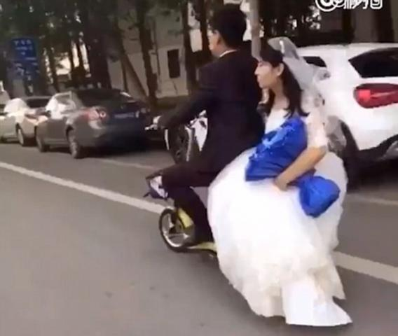 Fail: Bride falls hard off of the back of groom's scooter