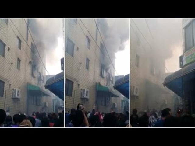 Shocking moment woman drops 3 kids from burning building +18 Please