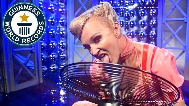 Most fan blades stopped with the tongue in one minute - Guinness World Records