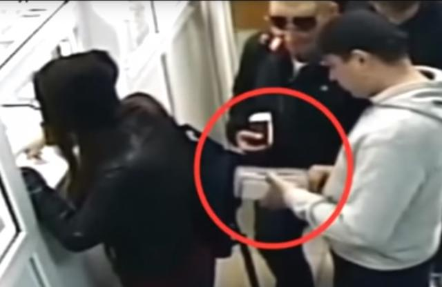 Thief fail: Moment a sneaky thief exacts revenge on queue-pushing girl