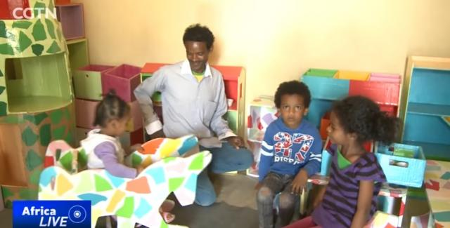 Ethiopian man turning recycled paper into furniture